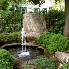 Fountain and rocks in front garden