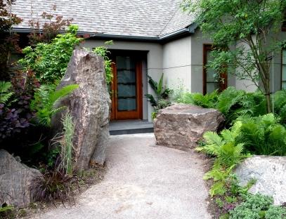 Towering rocks at a front door