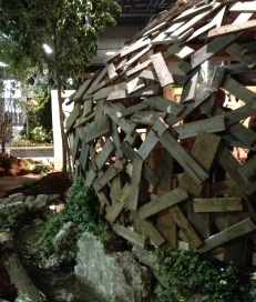 A dome-like pergola made of recycled pallets.