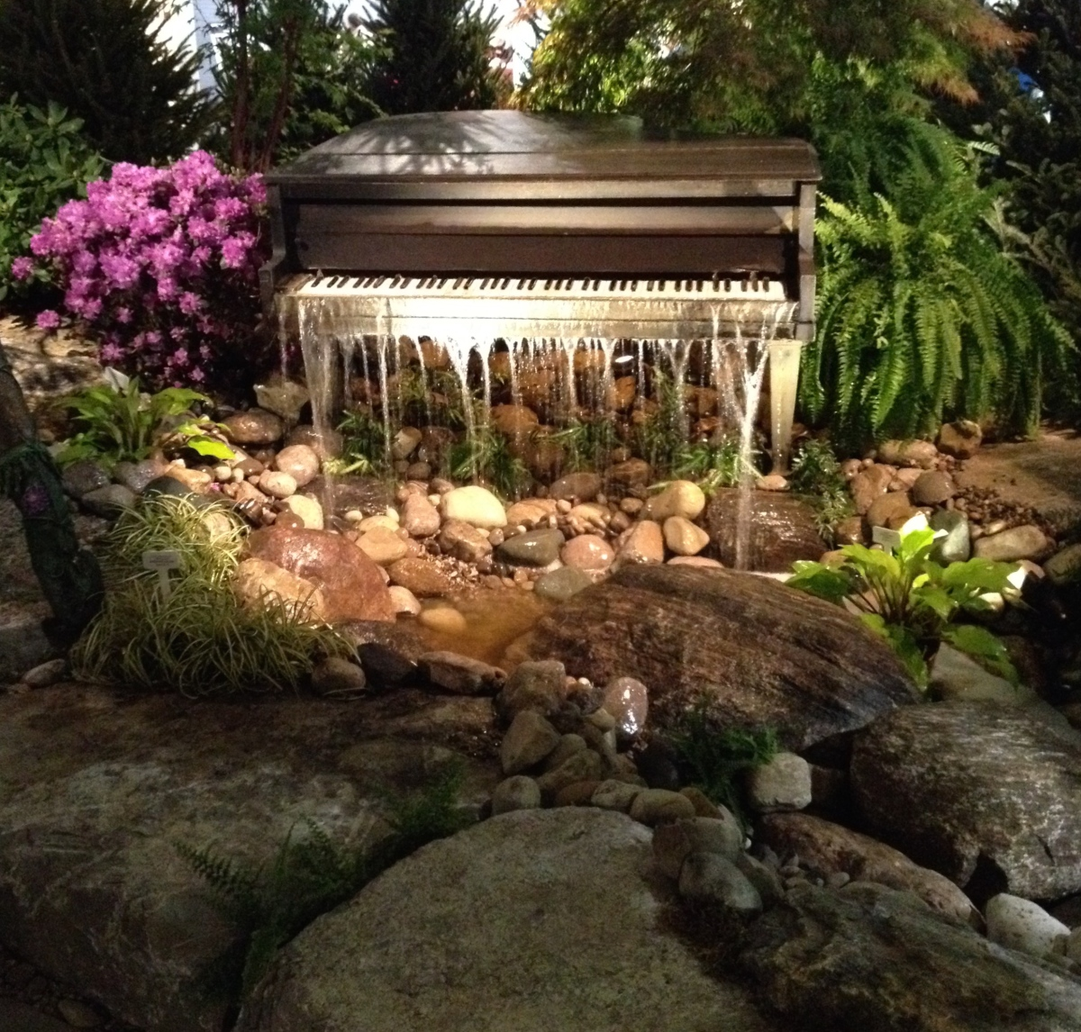 A piano is recycled into a garden water feature.