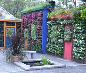 Walls resembling homes are covered with vertical garden installations.