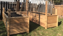 A raised bed made of wood on a lawn.