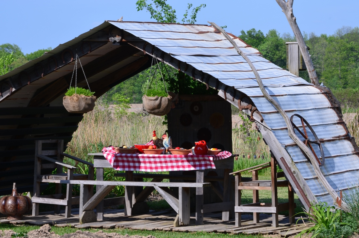An outdoor seating area with a farm theme.