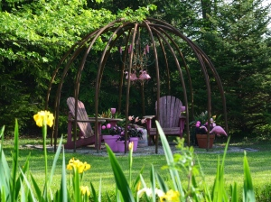 A garden seating area with a pink theme.