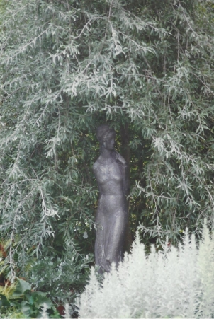 A sculpture of a stylized female form at Sissinghurst