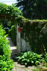 Walls add privacy, height and and sense of mystery in a small garden.