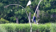 A wind powered garden sculpture named Wind Orchid by kinetic sculpture George Sherwood.
