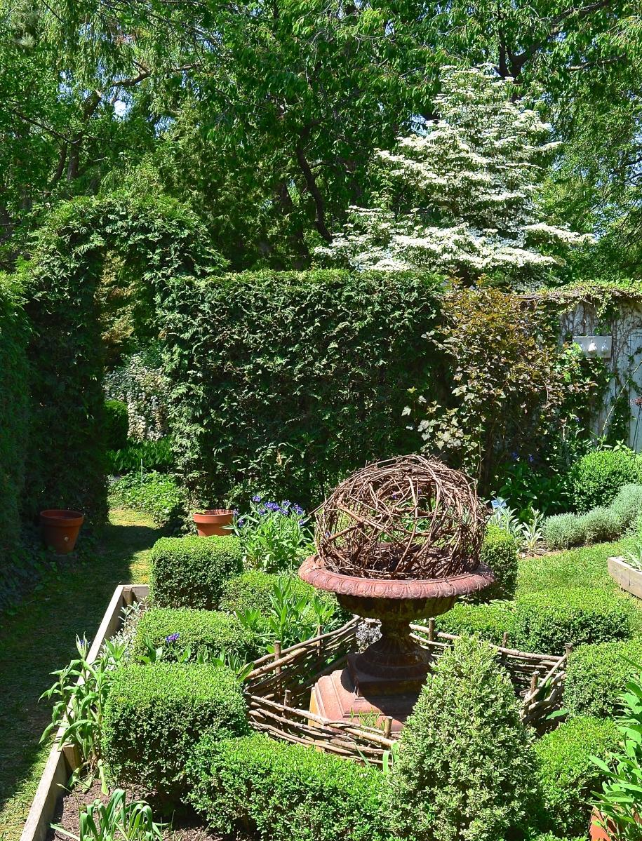 A secret garden has a formal look.