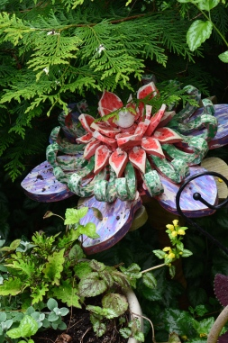 A carved flower in a garden.