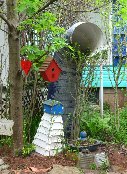 A ship's funnel is used as a garden decoration.
