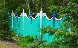 A funky fence with scroll work