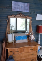 A dresser inside the cliffside beach bunkie