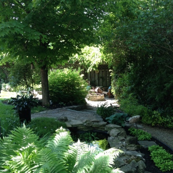 A pathway leads along the width of a small garden.