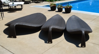 Three pool lounge chairs look like leaves.
