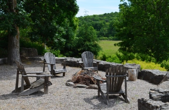 Outdoor seating next to a bonfire pit