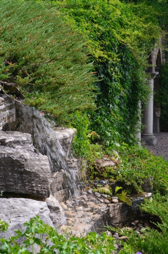 A large water feature is flanked on one side by columns