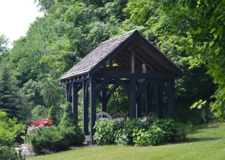 A wooden gazebo with chandelier