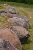 Boulders act as a retaining wall and as a rock garden.
