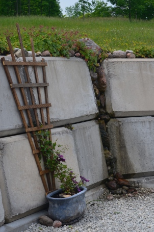 A close up of a retaining wall shows how the blocks are used to create a water feature.