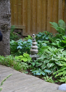 A stacked pile of stones becomes garden sculpture