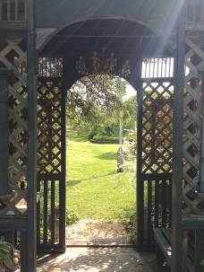 A latticed archway provides garden seating.