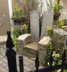 A large garden chair is made of stone.