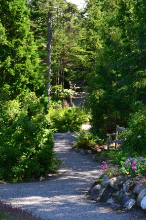 A pathway through a forested section of Reford Gardens.