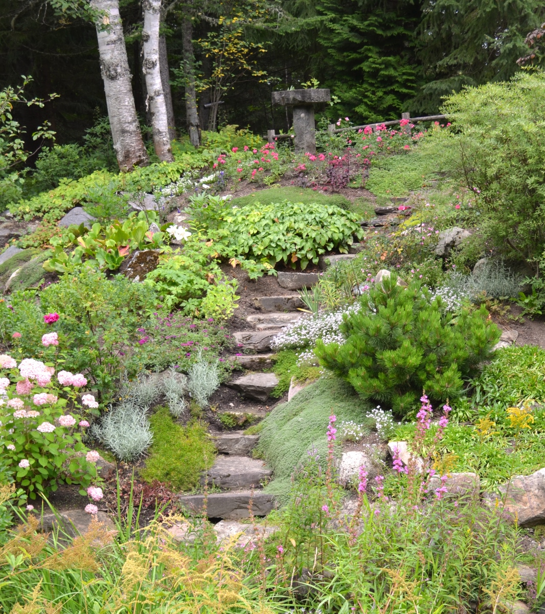 An example of garden design showing a stone stairway in Reford Gardens.