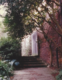 A doorway leads from one outdoor garden to another at Sissinghurst.