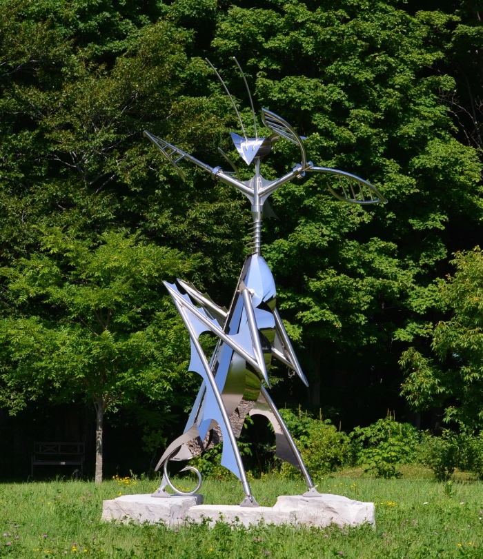 A large praying mantis garden sculpture