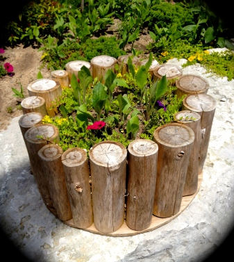 Logs are used to make a large plant container