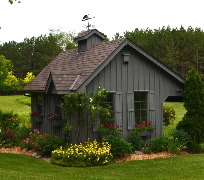 An adorable garden shed brings your attention back from the long views to meadow and forest.