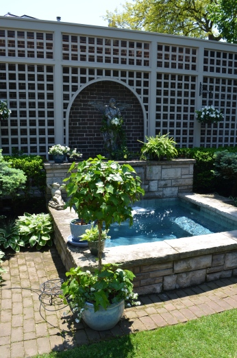 A hot tub acting as a garden focal point.