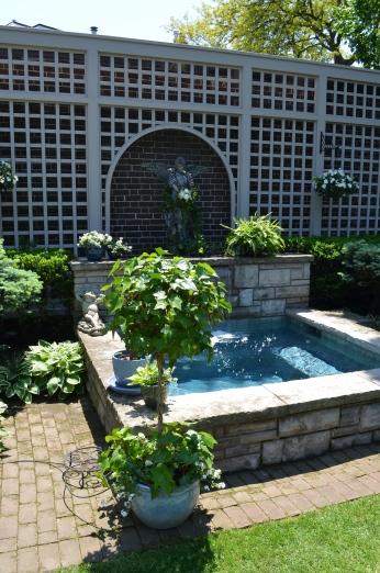 A hot tub acting as a garden focal point.