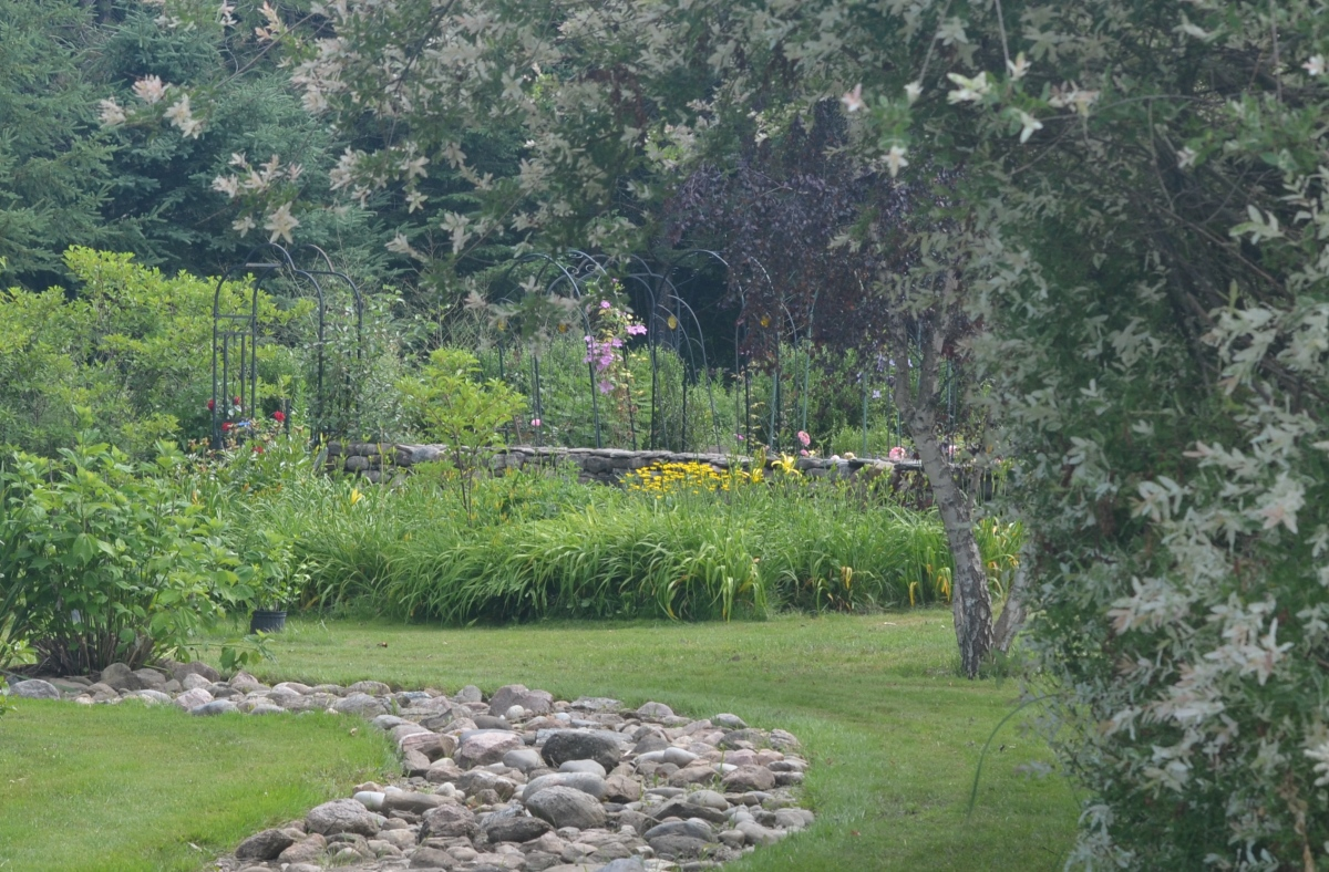 A walled garden becomes a garden focal point with a collection of plant supports.